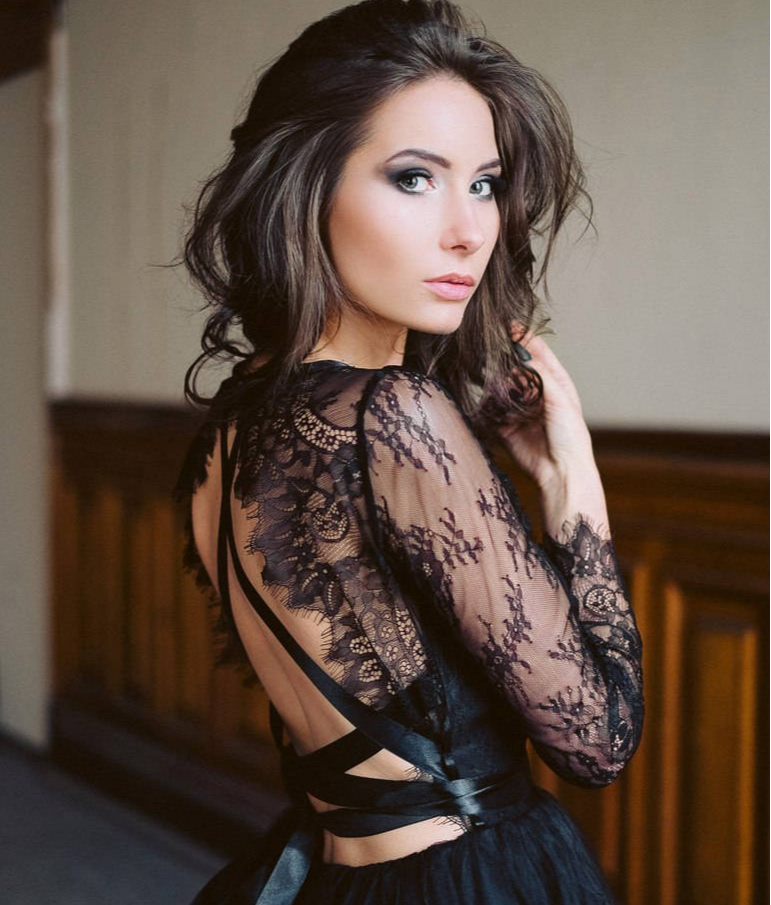 This black wedding dress is made with black lace and is the perfect alternative wedding dress.
