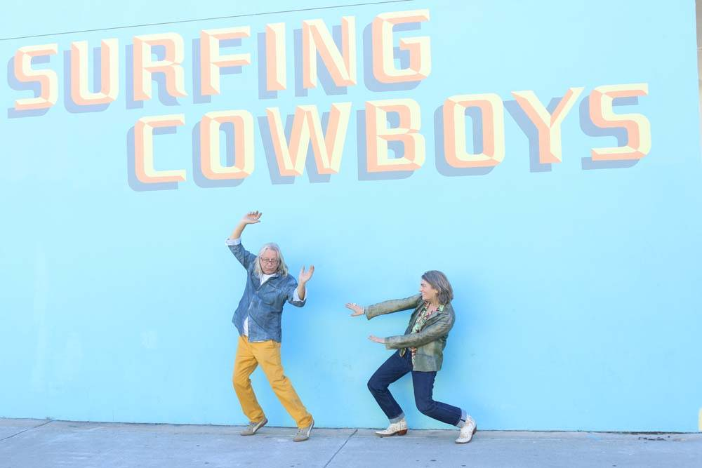 wayne and donna outside the surfing cowboys store