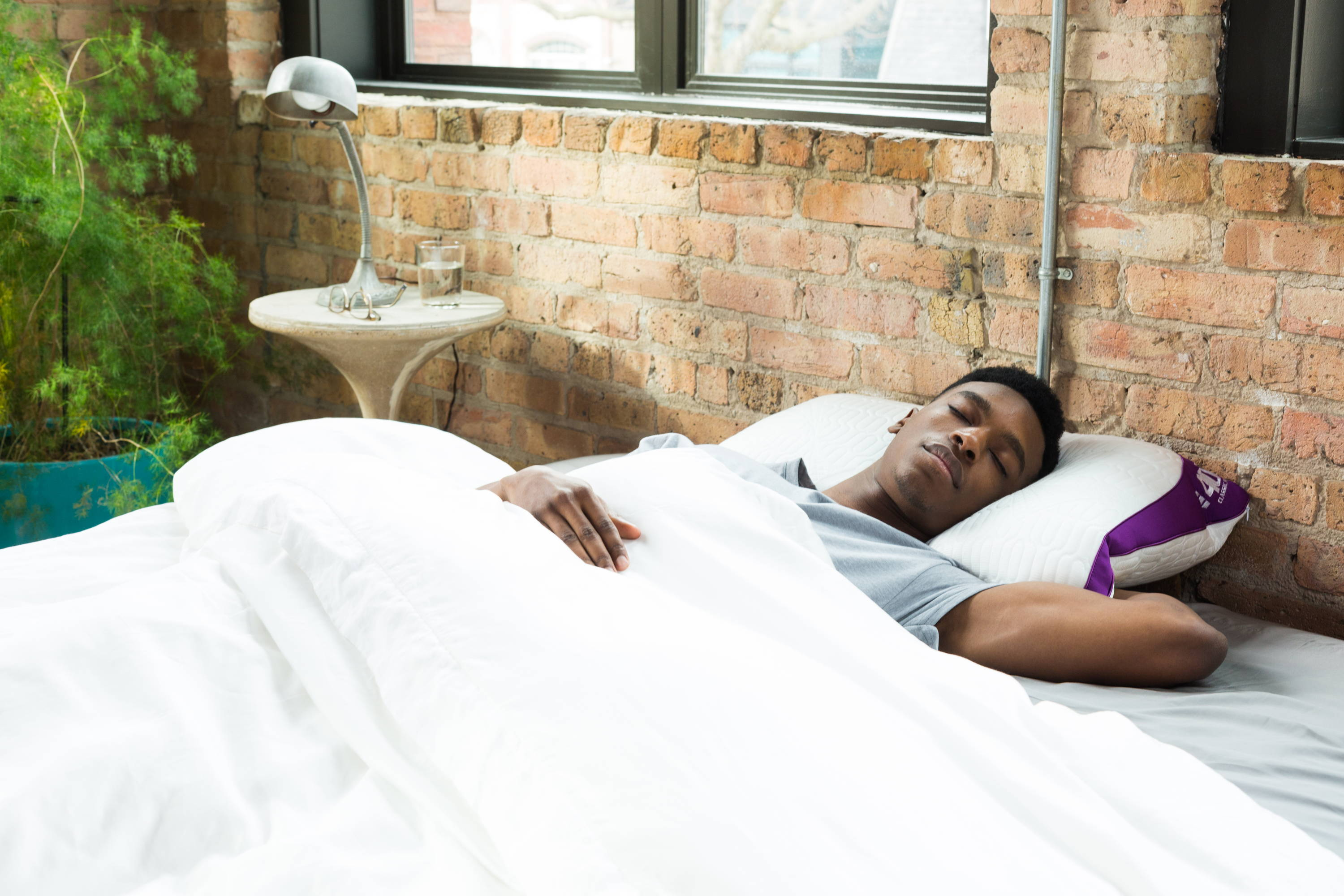 What Type of Mattress is Best for Me? . man sleeping on back on 400 cooling pillow