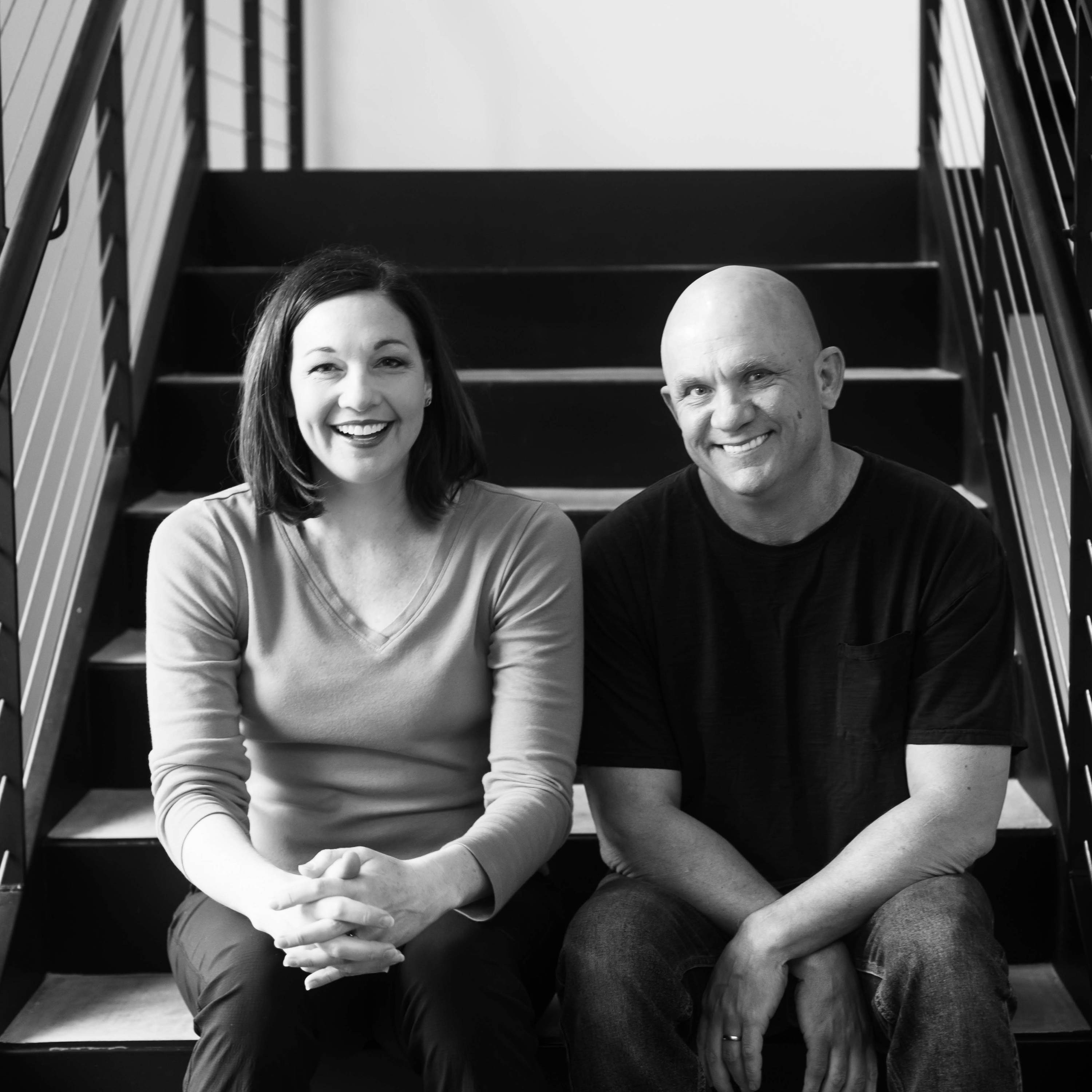 Eosera founders and EARWAX MD creators smiling on stairs.