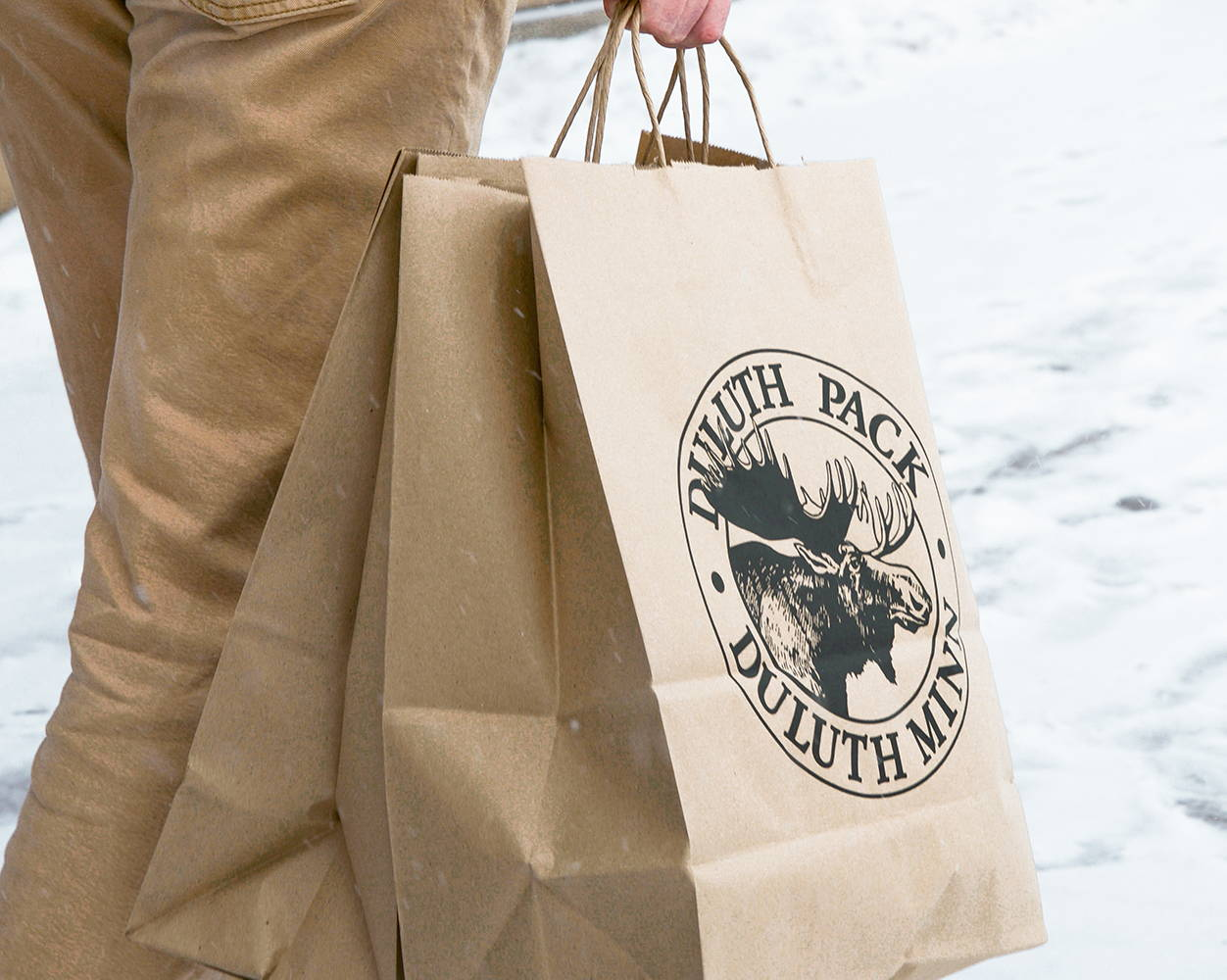 Image of Person Carrying a Duluth Pack shopping bag  in the snow