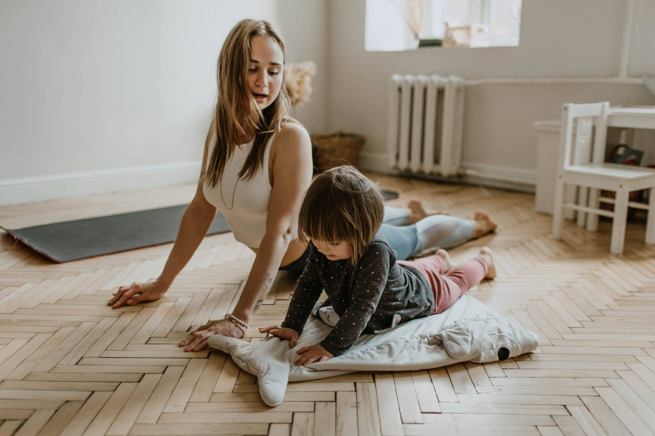 Parent And Child Doing Yoga