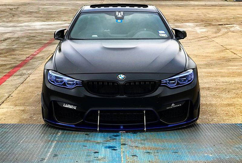 BMW with Blue Lamin-x headlight film covers