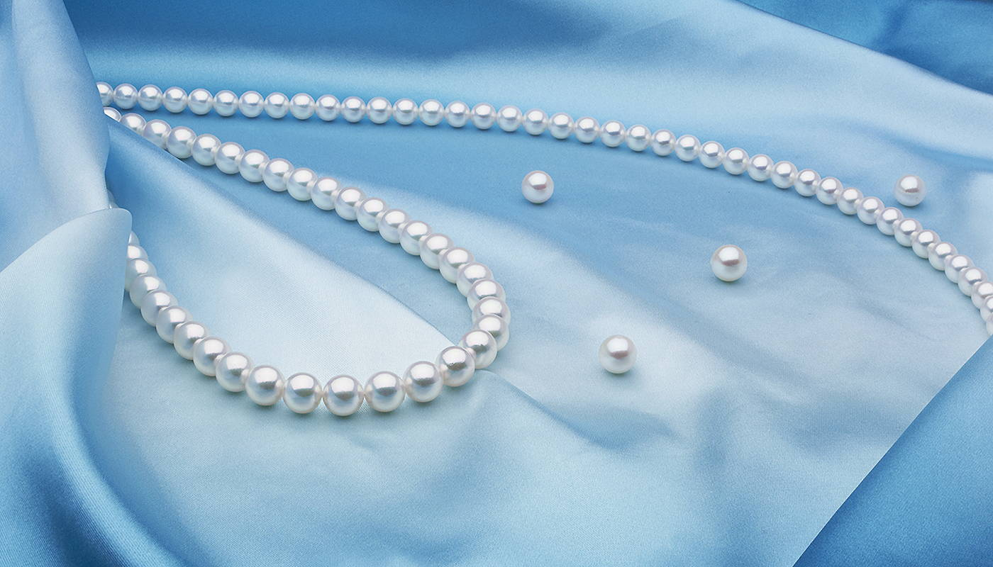 Cultured Japanese Akoya Pearls on Blue Silk - Glamour Shot