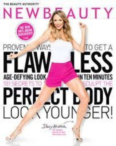 New Beauty magazine cover with woman standing in fun pose in pink shorts with long wavy hair