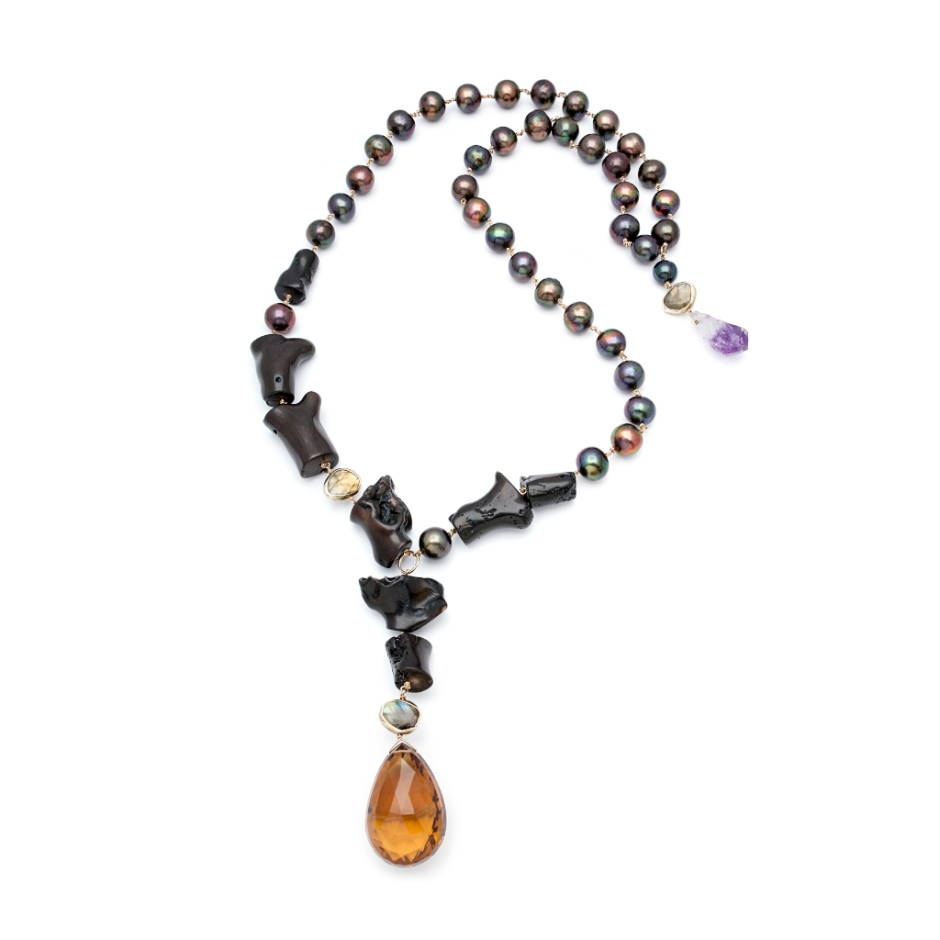 The Gothic Peacock Necklace: A show-stopping giant teardrop citrine is framed by gothic black coral and luminous peacock pearls with flashing labradorite gemstones and a rough teardrop amethyst at the back.