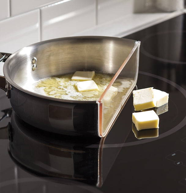 Demonstration of induction technology - induction only heats the area that contacts the cookware.