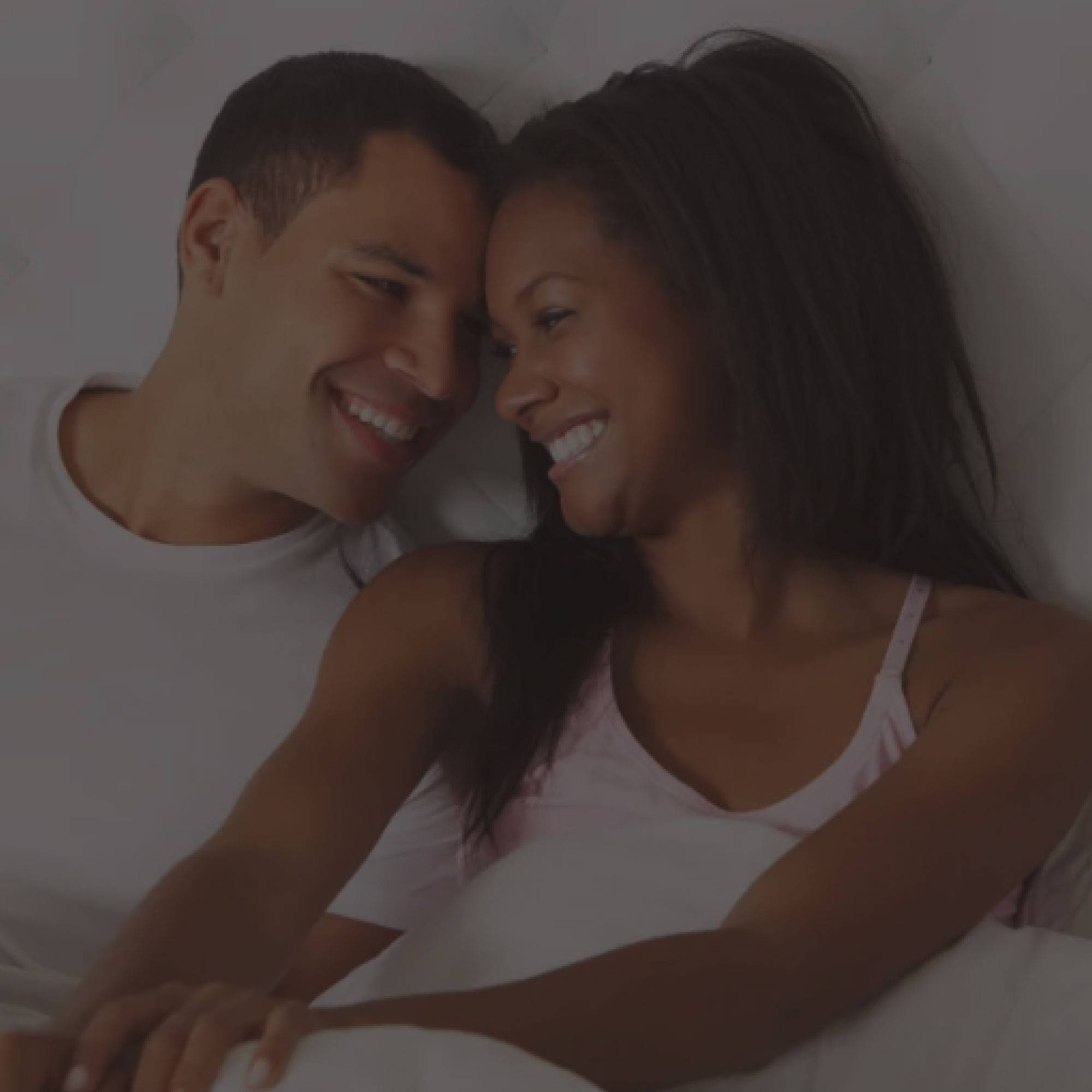 Sleep Product Guides. coupling smiling at each other in bed