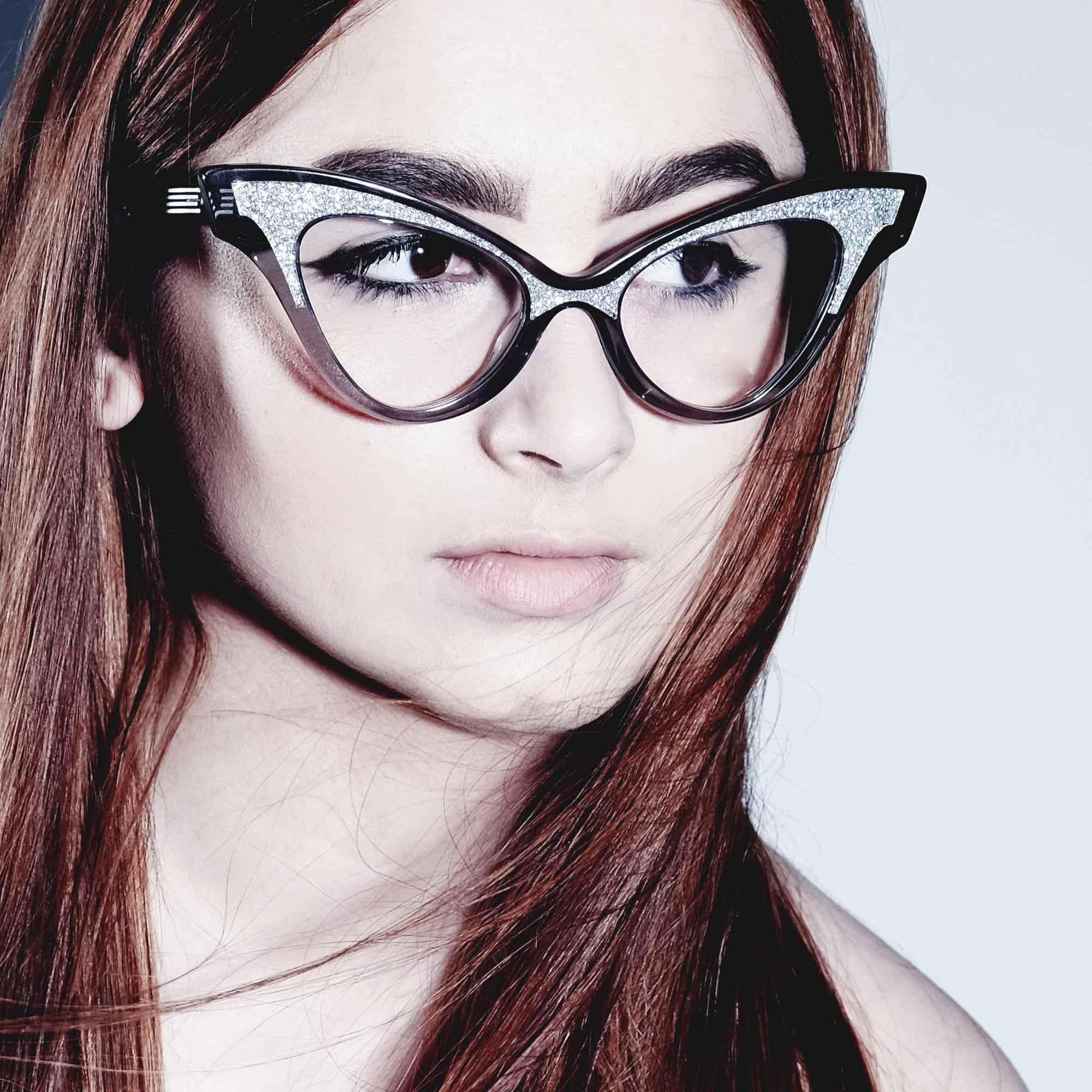 Female model wearing joiuss glimmer clear black sparkle glasses