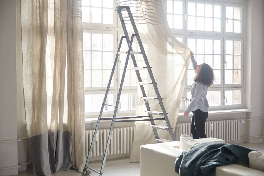 hanging linen curtains on a ladder