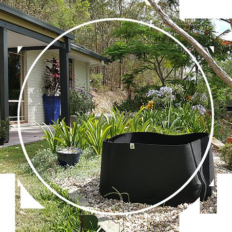 An Ecogardener square grow bag in the garden