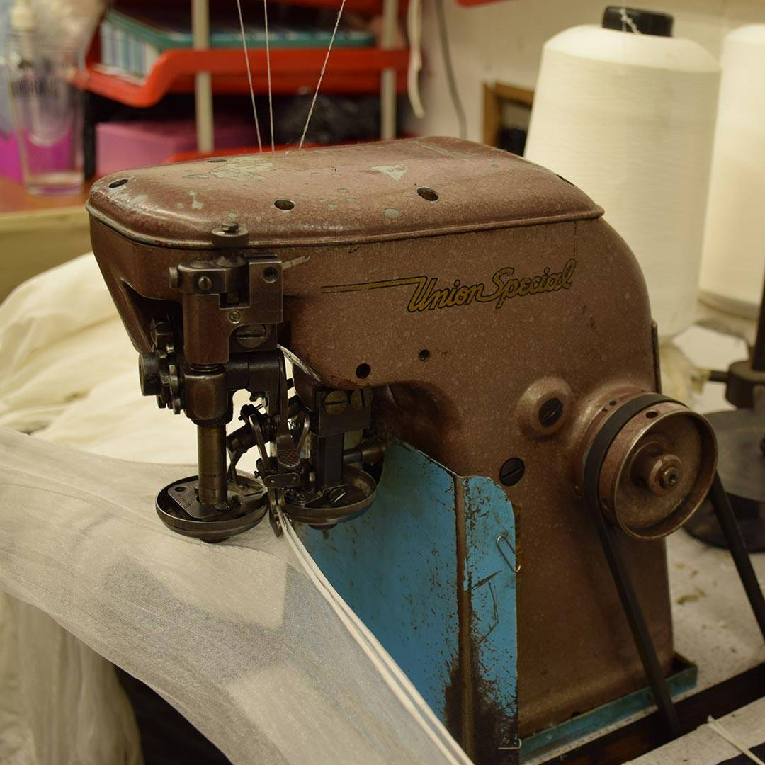 Seam sewing machine for fully fashioned stockings