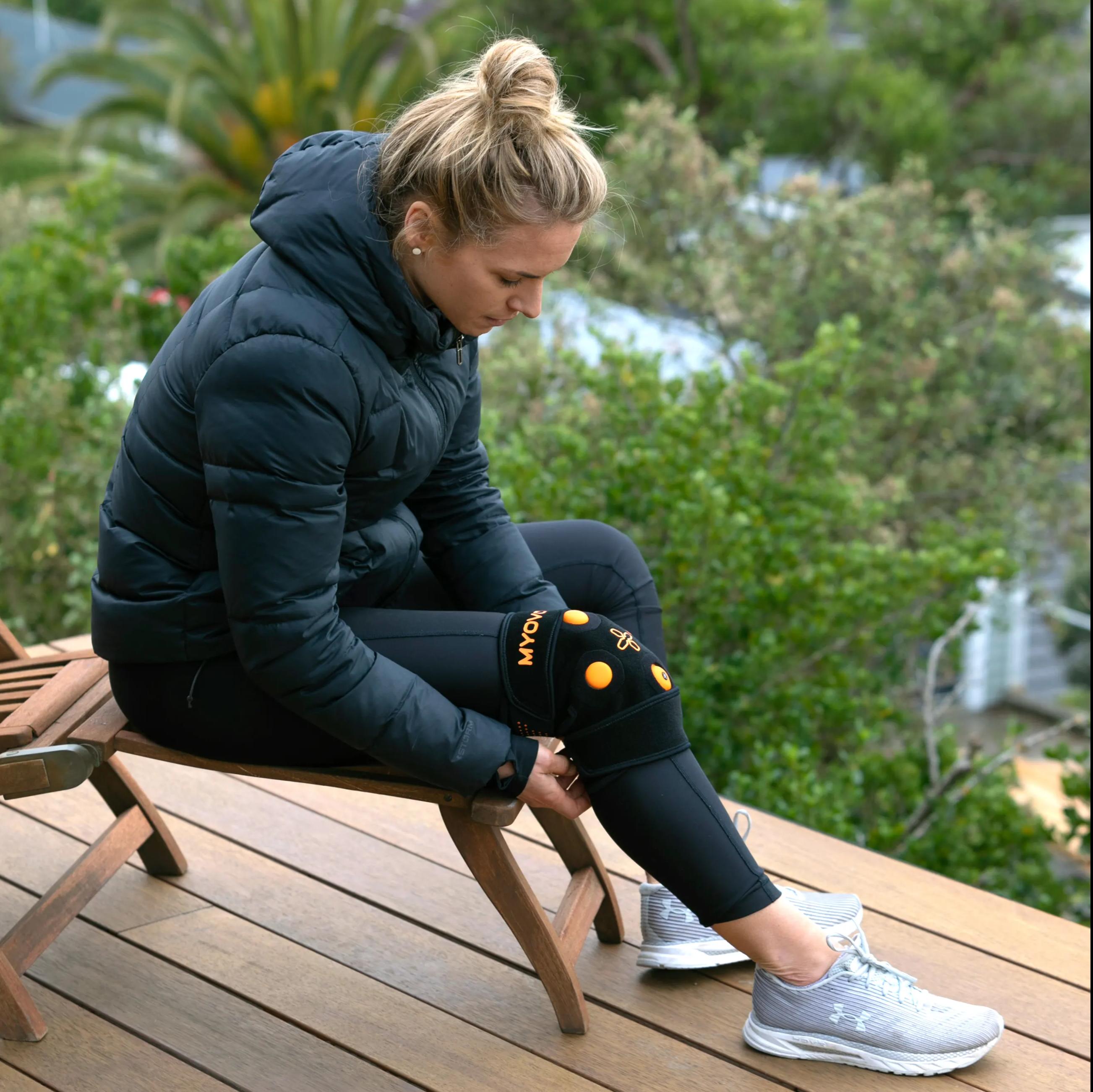 Dr Hannah Wells putting on Myovolt Leg  on bench