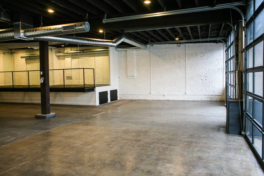 Photography studio with large garage doors that pour in natural light