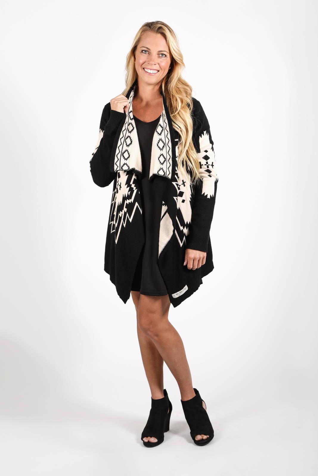 Model wearing the Nani Cardigan over the Ina long Sleeve Dress by illuminative