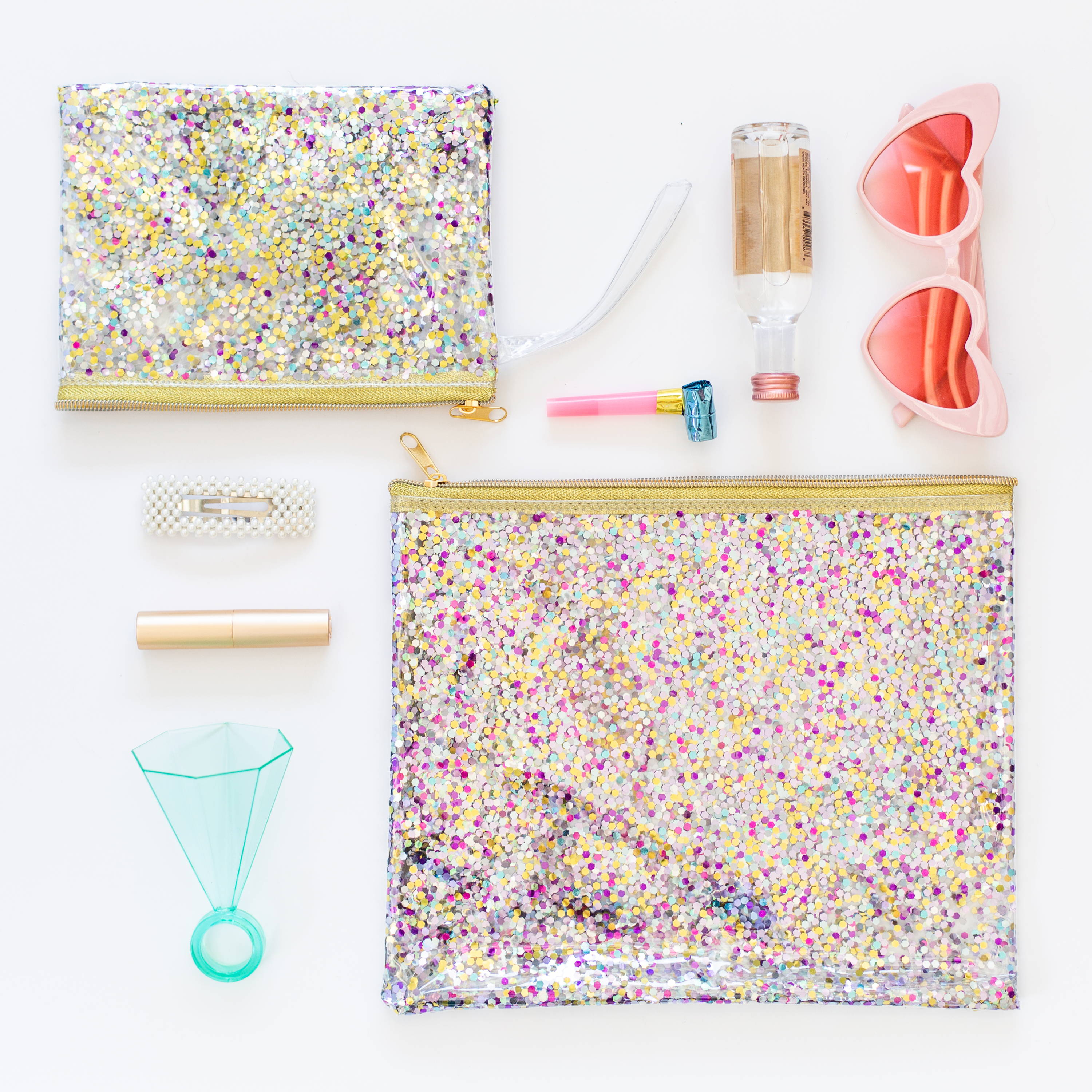 a photo of two cute confetti pouches with small items next to them