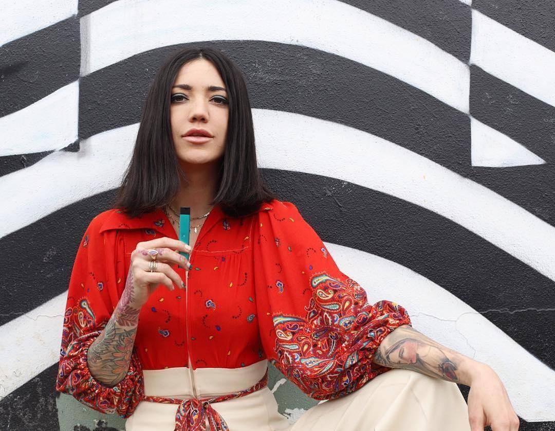 Woman puffing Fashionable Stylish Vaporizer KandyPens RUBI