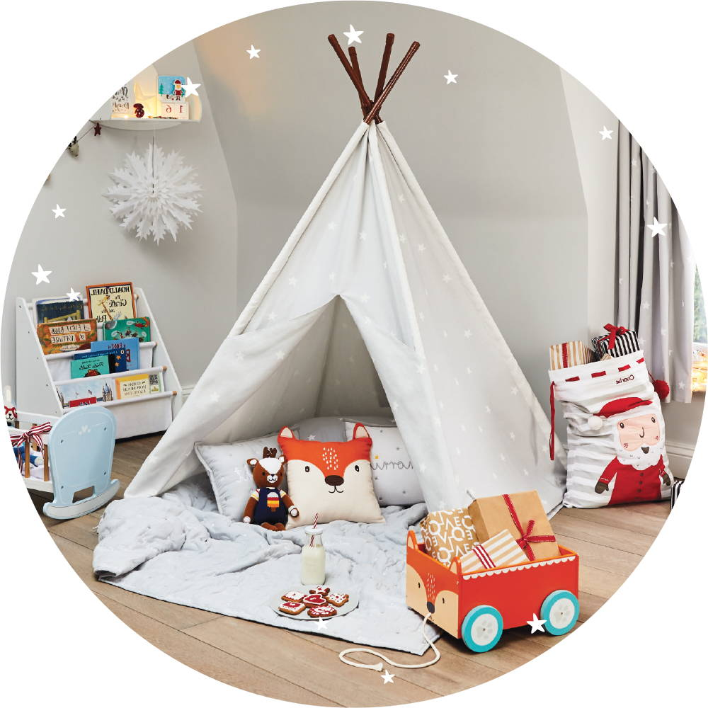 Play teepee with cushions and quilt. Also features book storage units