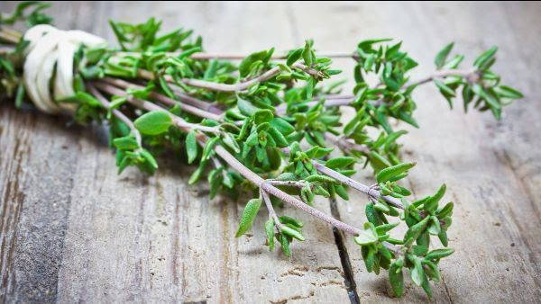 thyme on a wooden cutting board