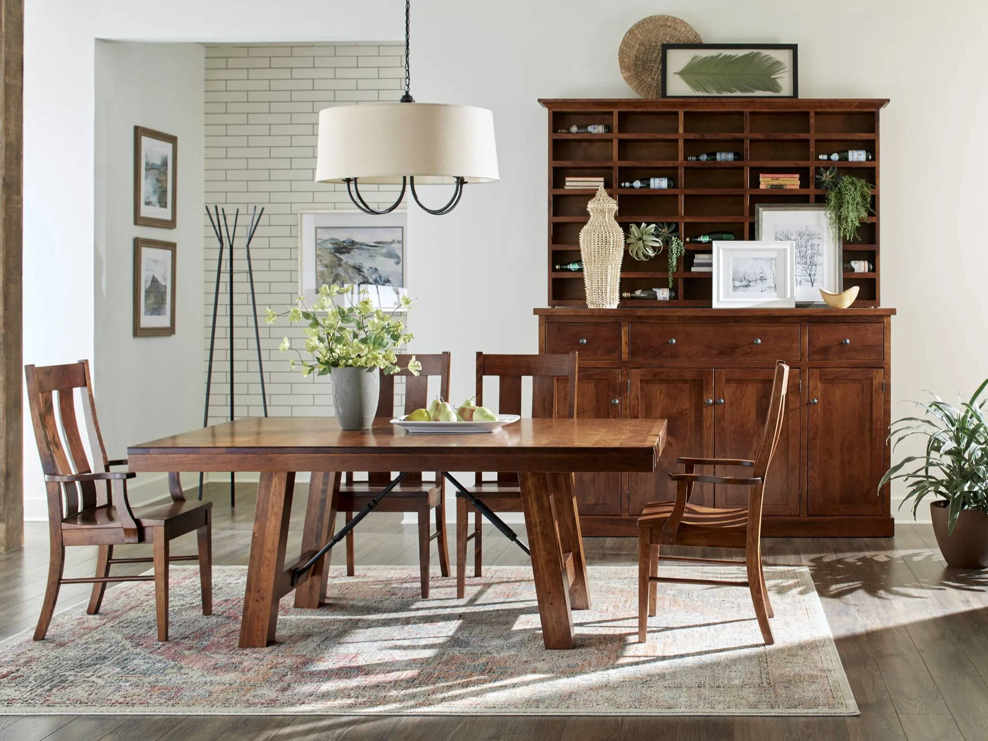 wood dining chairs around a dining table with a large china cabinet in background