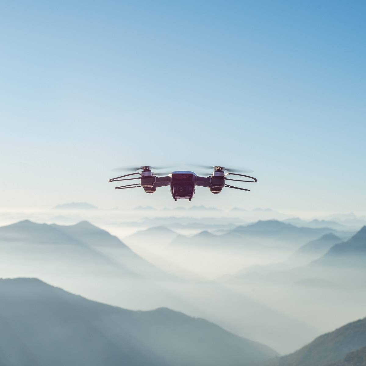 A drone flying over misty mountains