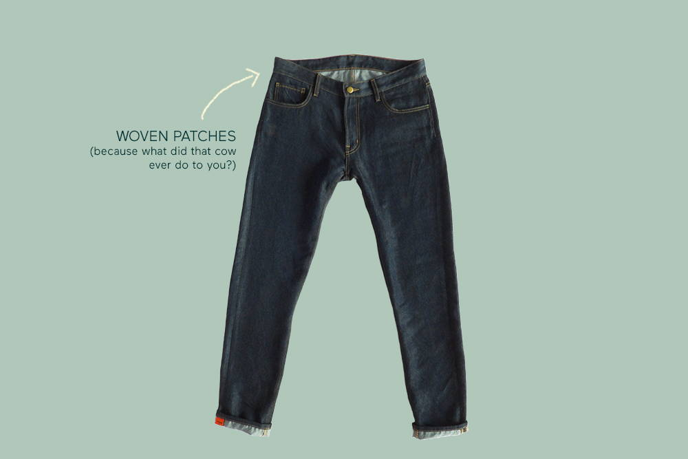 Comfortable again&again jeans with an arrow pointing to the woven patches