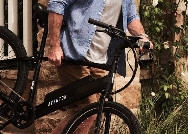 man carrying pace 500 ebike down stairs