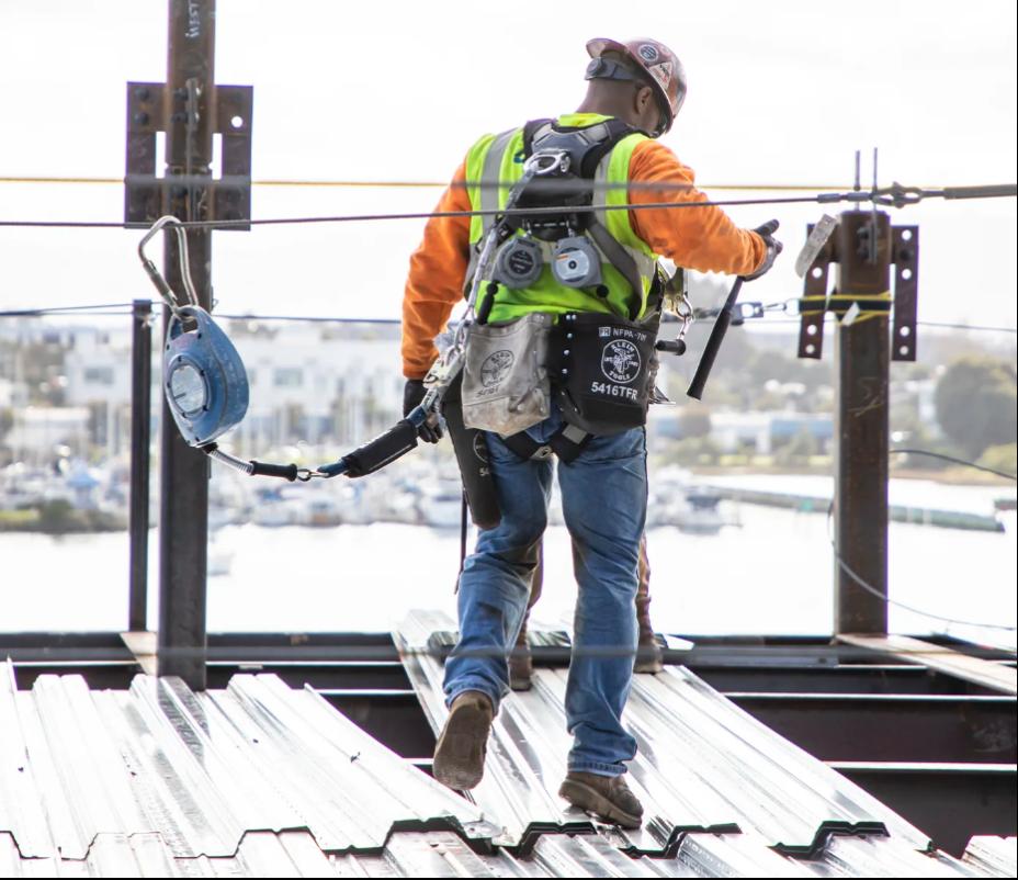Construction worker walking across metal decking using DuraTech  self-retracting lifelines