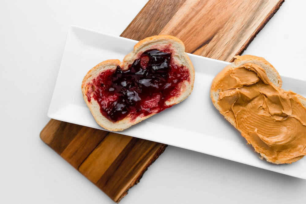 Peanut butter and jam on bread on a plate