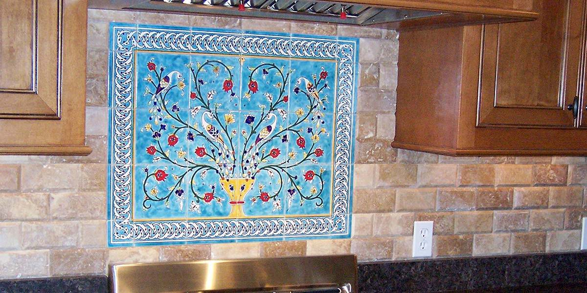 Peacocks and pomegranate tree mural with blue border tiles