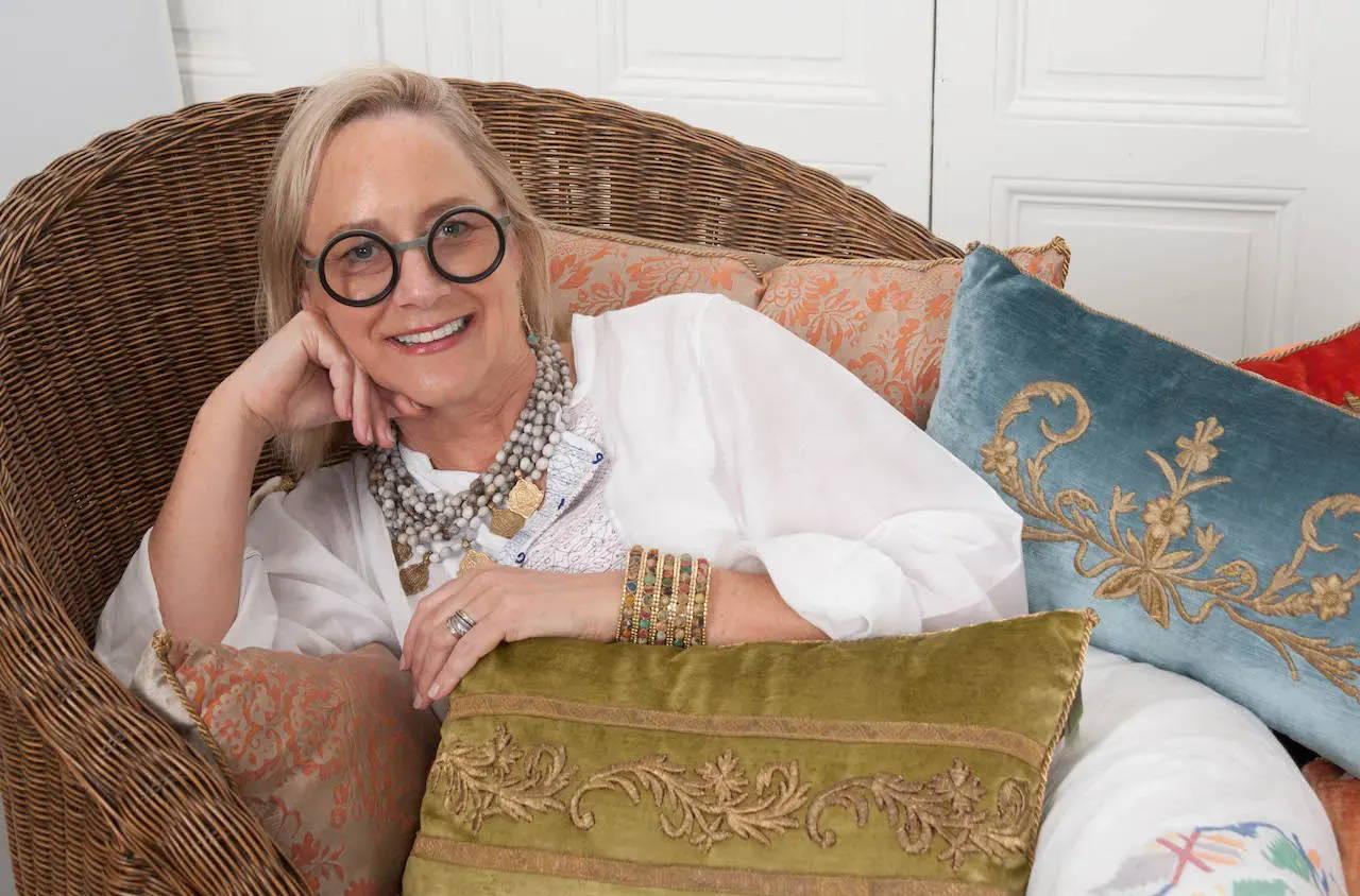 Rebecca Vizard lounges with her exquisite antique textile pillows in the B. Viz Design studio in St. Joseph, LA