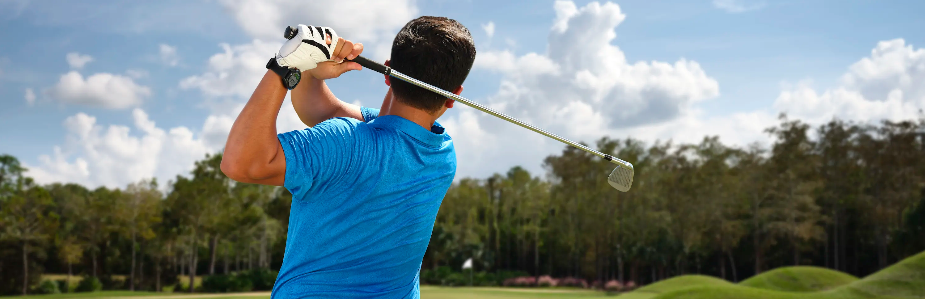 Golfer swinging on the course