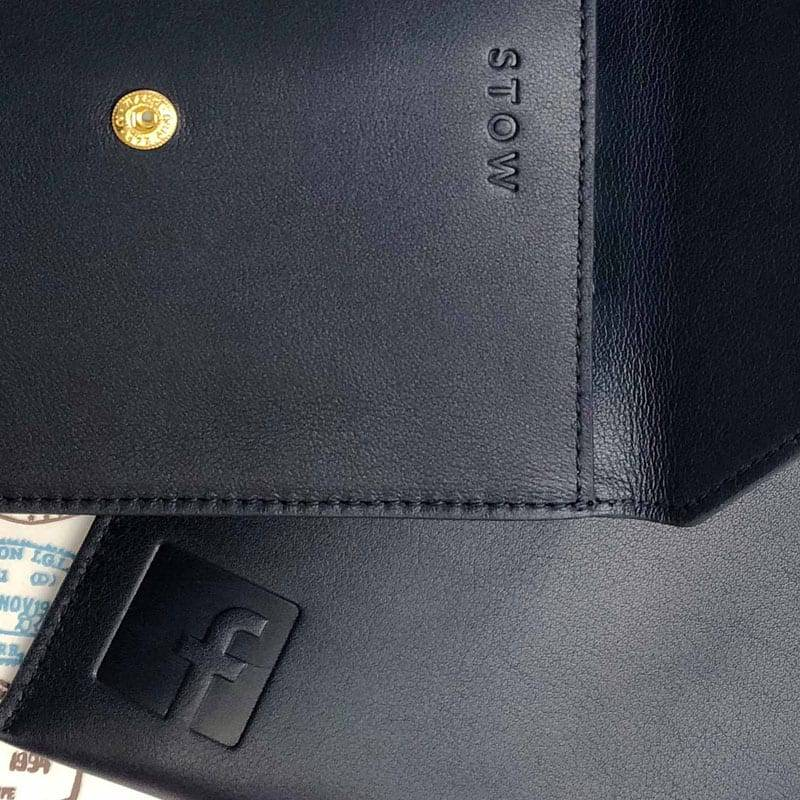 leather accessories with embossed facebook logo