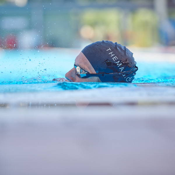 Jan Frodeno in the water swimming with goggles on