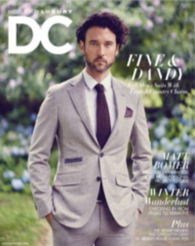 DC Modern Luxury magazine cover, standing man with grey suit