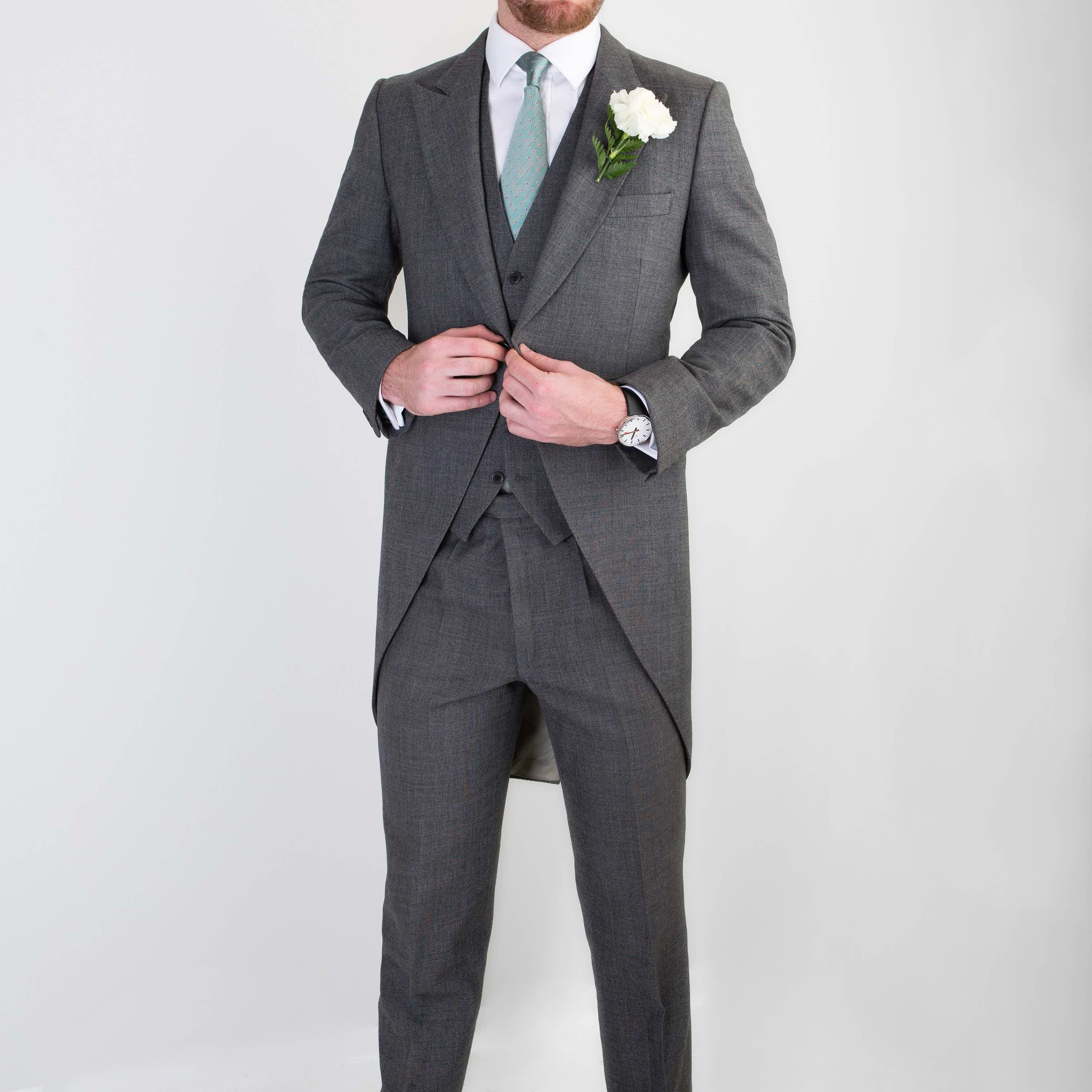 Bespoke three piece wedding suit with morning coat by Mullen and Mullen bespoke gentlemans tailors