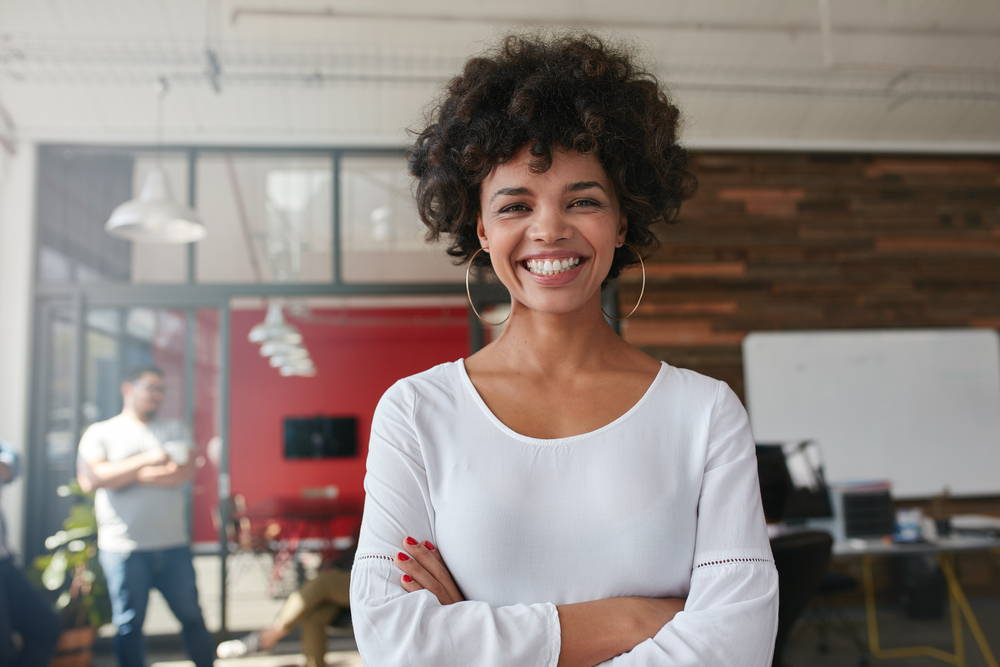 woman smiling  at work|CBD for Women's Health and Balancing Your Hormones