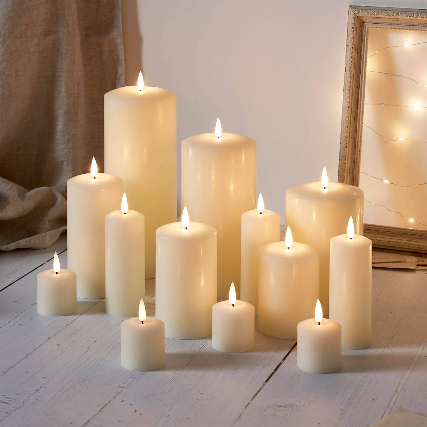 Truglow candle bundle illuminated and styled at differing heights on floor
