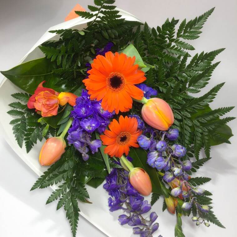 Bright flowers in a roll wrap