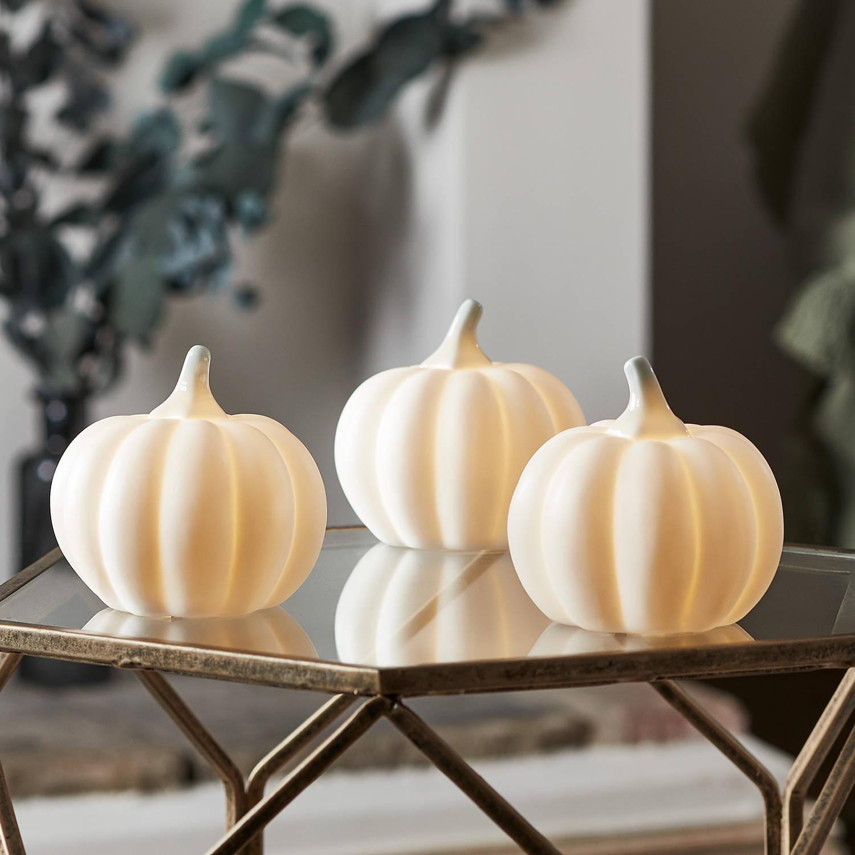 Trio of ceramic pumpkin lights