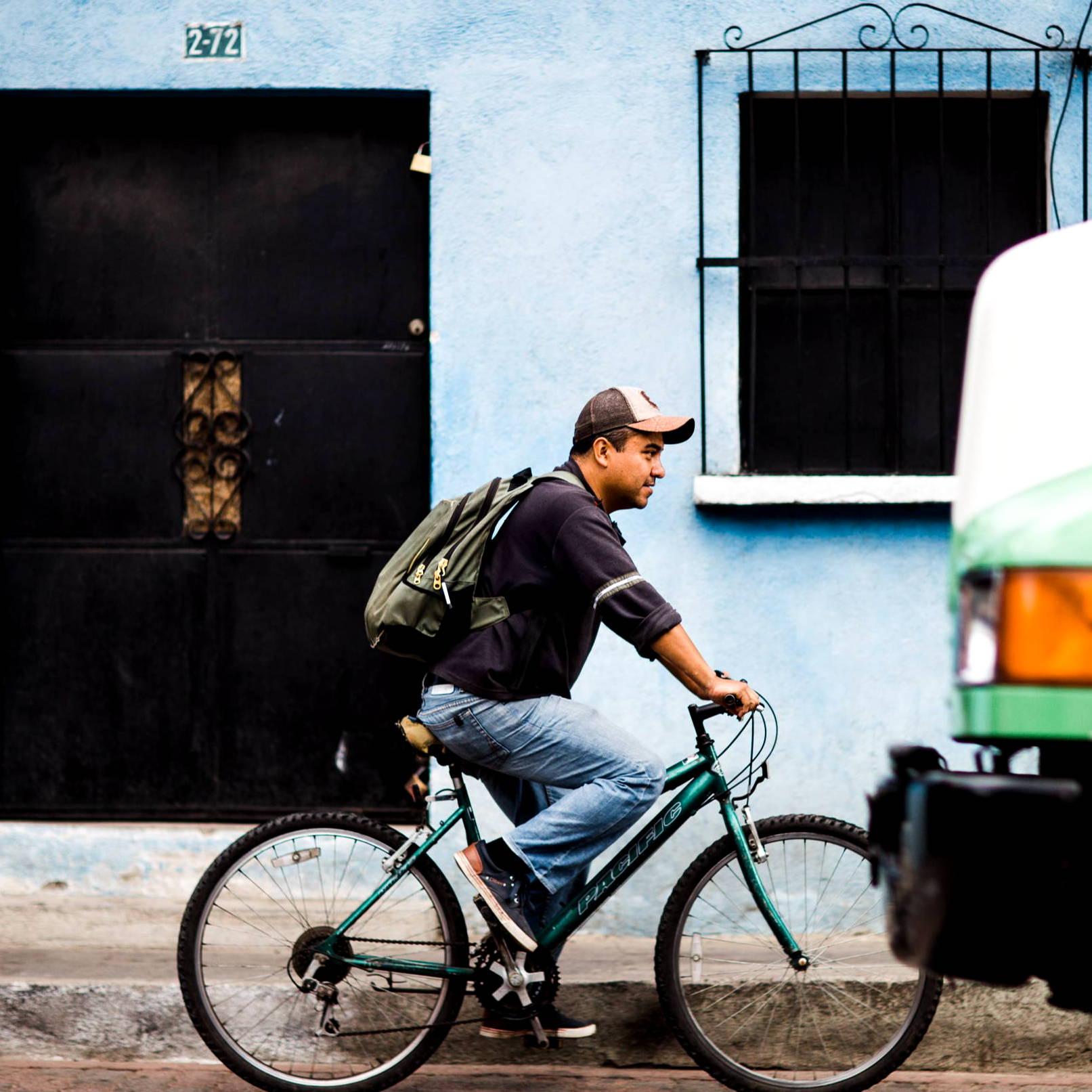 Artisan riding a bicycle to work
