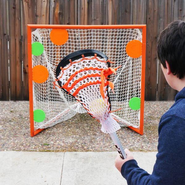 Magnetic shooting targets on lacrosse goal net