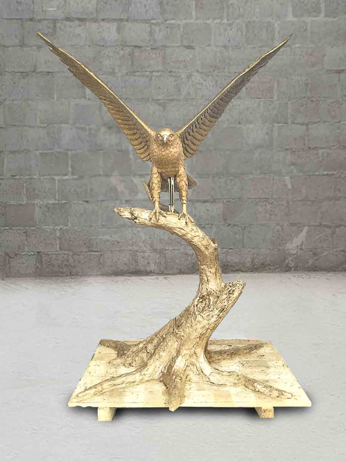 Cast Mold of a red hawk with wings spread out and standing on a tree