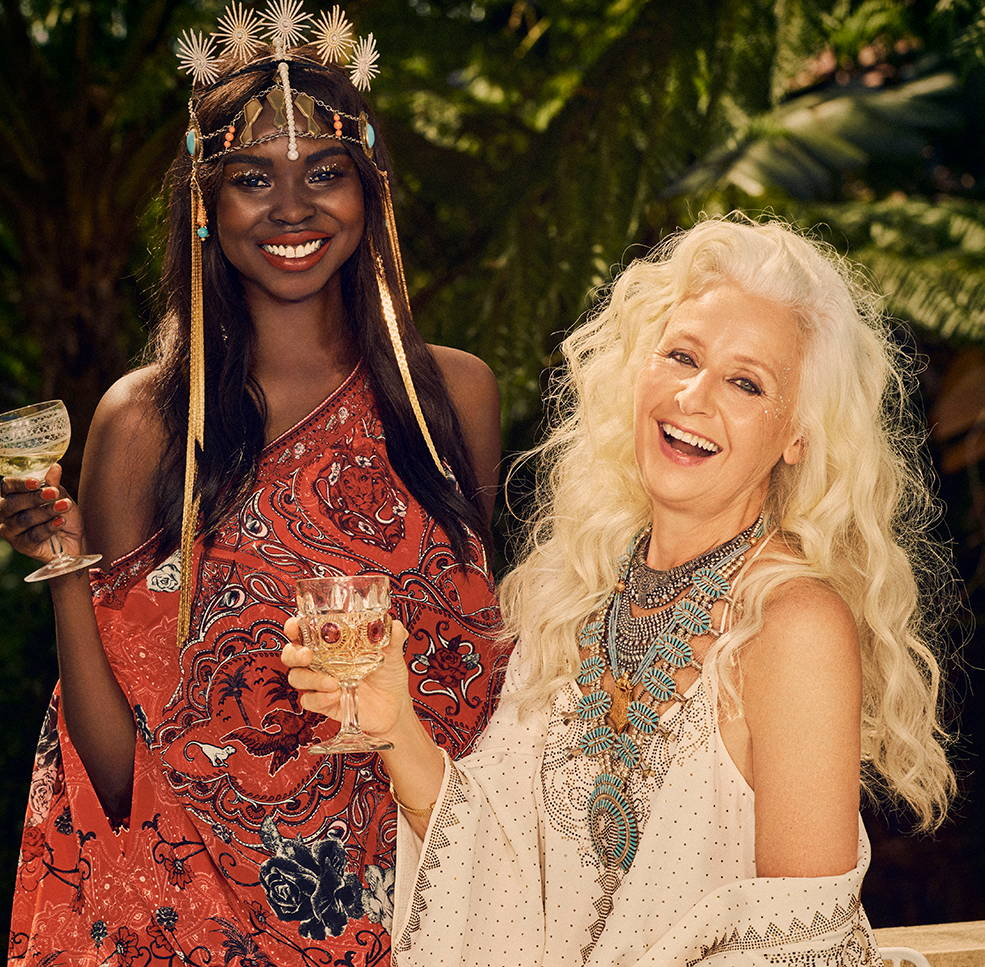 Yaya Deng and Sarah Jane Adams wearing CAMILLA collection at party with champagne