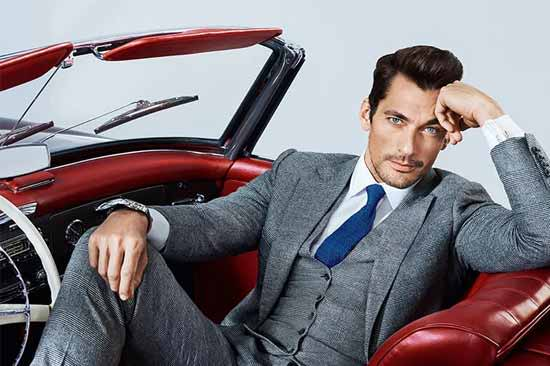 David Gandy in grey suit sitting in a classic car