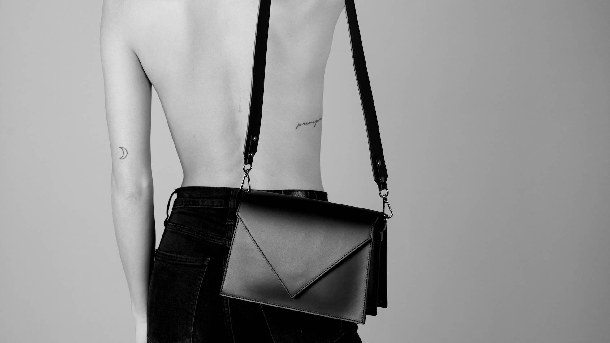 VESTIRSI Italian Leather Handbags for women CLAIRE smooth Italian crossbody bag in black on topless fashion model