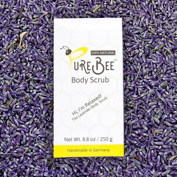 PureBee Lavender Body Scrub on a bed of lavender blossoms