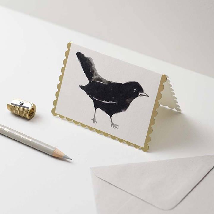 A Wanderlust Backbird mini card.