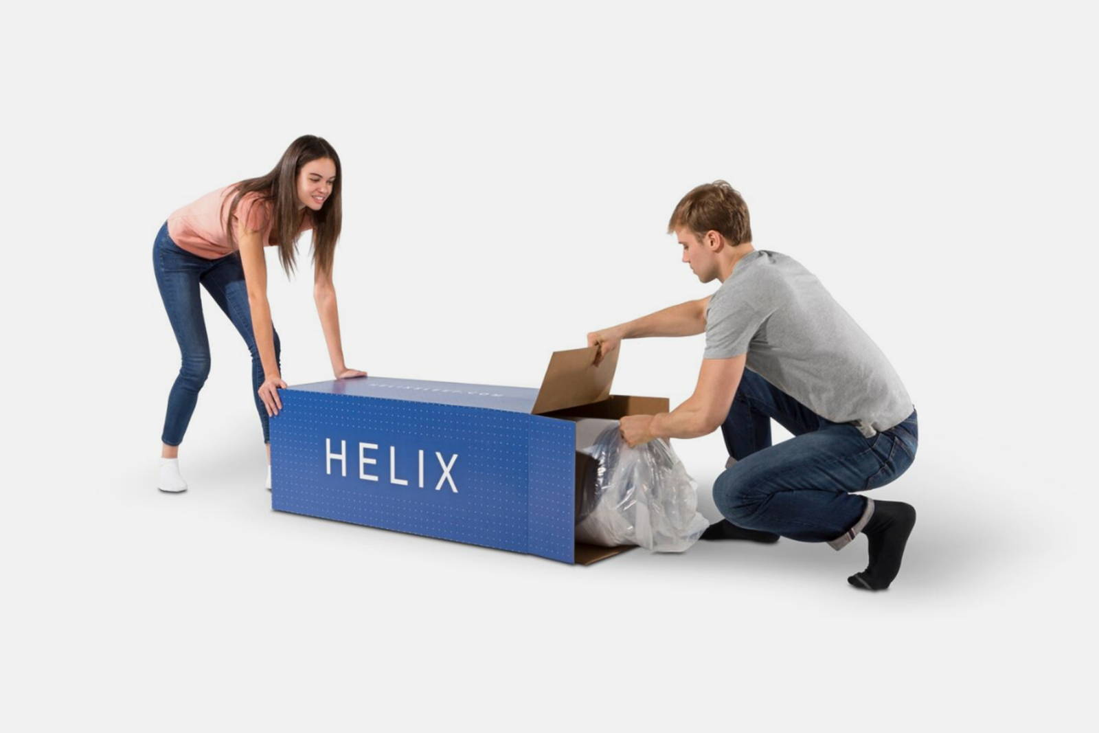 A couple unpacking their new Helix Mattress from the box