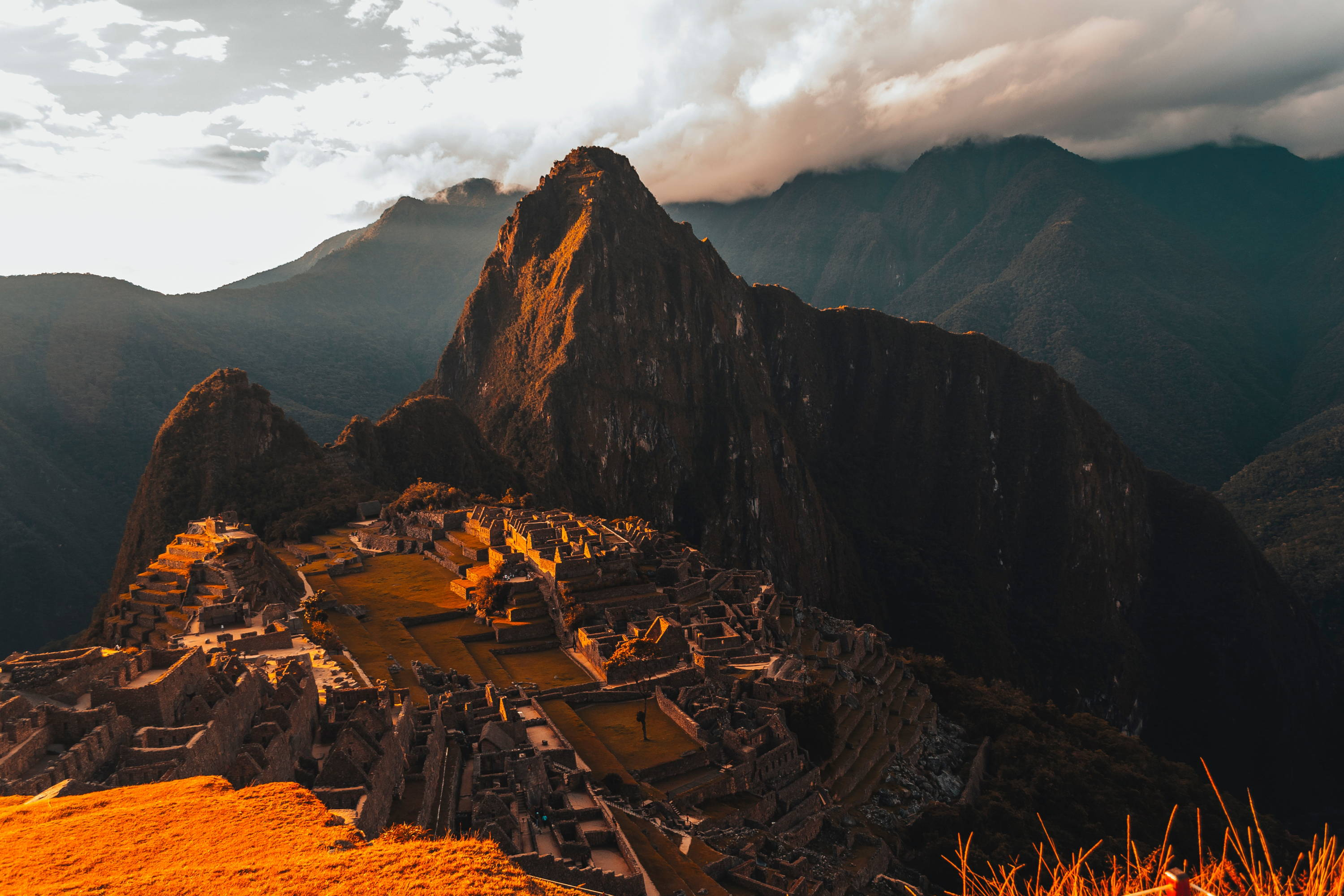 Sun sets over the Inca Trail Hike up to Machu Piccu with golden hue.
